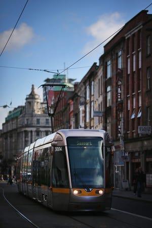A tram makes its way through Dublin city centre.