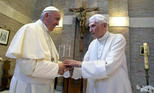 In this June 28, 2017, file photo, Pope Francis, left, and Pope Benedict XVI, meet each other on the occasion of the elevation of five new cardinals at the Vatican.