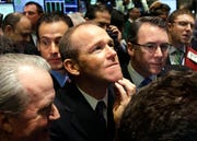 In this Jan. 26, 2011 file photo, Nielsen Company CEO David Calhoun, center, watches progress as he waits for the company's IPO to begin trading, on the floor of the New York Stock Exchange. Calhoun took over Monday, Jan. 13, 2020, as Boeing's third CEO in the last five years, following the firing last month of Dennis Muilenburg.