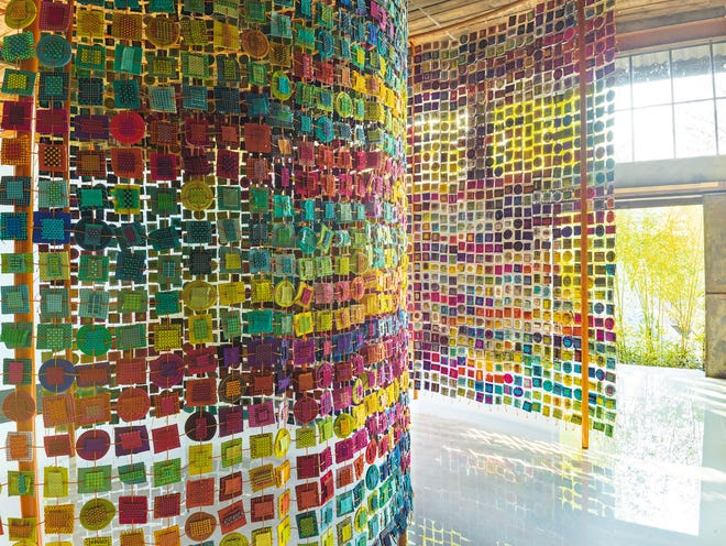 Master textile artist Paola Lenti created this extraordinary room divider out of small samples of her fabrics with stitchery showing a range of her extensive color palette.