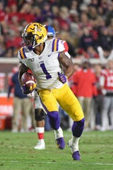 LSU's Ja'Marr Chase, this year's Bilentikoff Award winner, is part of three-receiver group that accounted for 48 touchdowns this season.