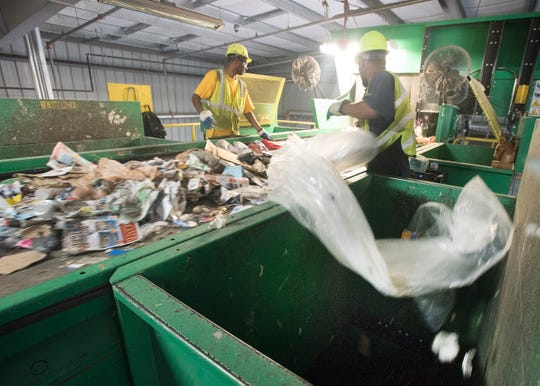 Plastic and plastic bags are cleared out of the material customers considered recyclable at the Resource, Recovery and Recycling Authority of Southwest Oakland County in Southfield in this Sept. 15, 2016, file photo. Gov. Gretchen Whitmer and state legislators want to double Michigan's recycling rate to 30% by 2025 and ultimately reach 45% annually.