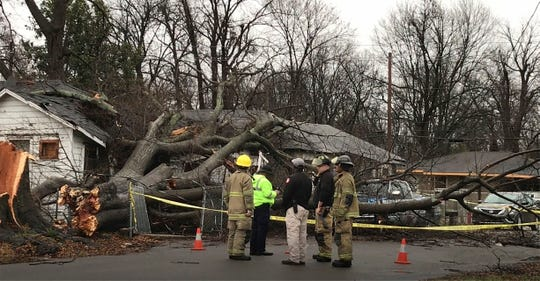 In this image taken from video, emergency personnel survey the damage from toppled trees in this Greenville, Miss., neighborhood, Saturday, Jan. 11, 2020.