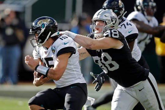 Maxx Crosby sacks Jaguars quarterback Gardner Minshew on Dec. 15.