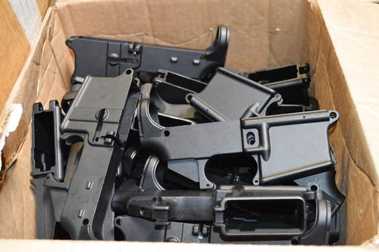 This photo provided by the U.S. Department of Justice shows AR-15 lower receivers, which federal agents have seized, including these unfinished ones taken in 2014 in California, for firearms investigations nationwide. For decades, the federal government has treated the mechanism called the lower receiver as the essential piece of the semiautomatic rifle, which has been used in some of the nation's deadliest mass shootings. But some defense attorneys have recently argued that the part alone does not meet the definition in the law.