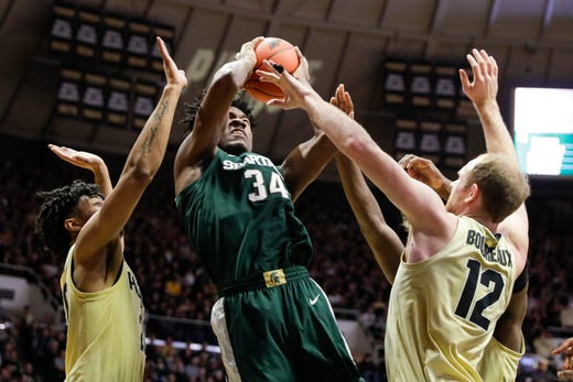 Michigan State Tumbles Michigan Steady In Ap College
