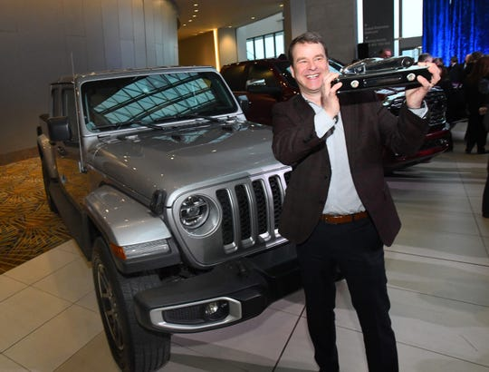Jim Morrison, head of Jeep North America, accepts the award for the 2020 North American Truck of the Year, the Jeep Gladiator, at the TCF Center in Detroit on Jan. 13, 2020.