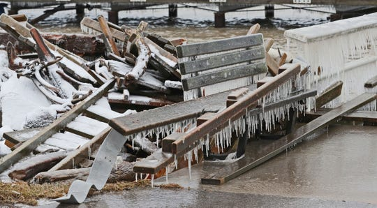 High winds from the recent storms pushed water ashore doing damage to piers at the South Shore Yacht Club in Milwaukee Sunday, January 12, 2020.