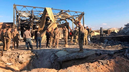 U.S. Soldiers stand at a site of Iranian bombing at Ain al-Asad air base in Anbar, Iraq, Monday, Jan. 13, 2020. Ain al-Asad air base was struck by a barrage of Iranian missiles on Wednesday, in retaliation for the U.S. drone strike that killed atop Iranian commander, Gen. Qassem Soleimani, whose killing raised fears of a wider war in the Middle East.