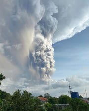 A small volcano near the Philippine capital of Tagaytay that draws tourists for its picturesque setting in a lake erupts with a massive plume of ash and steam Sunday.