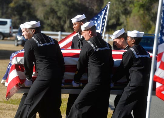 Sailors carry the casket of Cameron Walters at Oak Hill Cemetery in Richmond Hill, Ga., Monday, Dec. 16, 2019. Walters was one of the three Navy sailors killed in a Saudi gunman's attack at Pensacola Naval Air Station in Florida on Dec. 6.