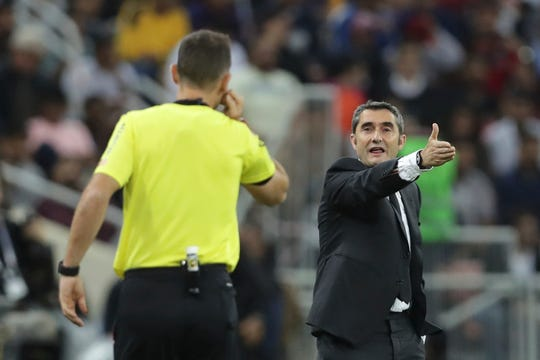Barcelona has made a rare coaching change midway through the season, replacing Ernesto Valverde (right) with former Real Betis manager Quique Setién.