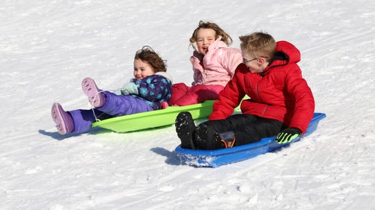 Children sled down Beach Front Hill at Hills Creek State Park during a recent Winterfest. This year's Winterfest will be on Saturday.
