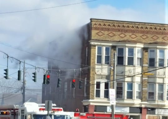 One person was injured Sunday when a blaze broke out in an apartment building in downtown Bath.