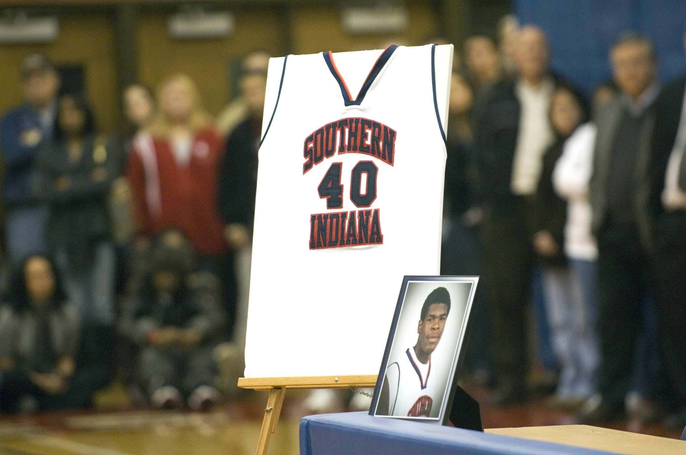 A photo of Jeron Lewis and his jersey were on display during a news conference about Lewis' death at the Physical Activities Center (PAC) on the University of Southern Indiana campus in Evansville on Friday, January 15, 2010.  Lewis died at the Owensboro Medical Health System after collapsing on the court during the Jan. 14, 2010 night's game against Kentucky Wesleyan College.