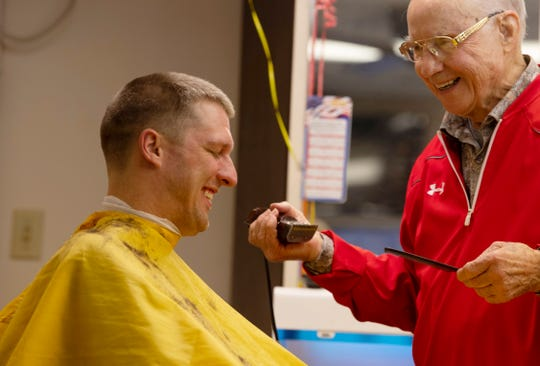 David Kappler asks for some more off the top from barber George Henson who was starting off his 90th birthday working at his shop, VIP Barber Shop, Saturday morning, Jan. 11, 2020.