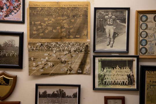 A large portion of one of the walls at George Henson's VIP Barber Shop is dedicated to his early football career at Central High School. Henson, 90, is still cutting hair at VIP Barber Shop.
