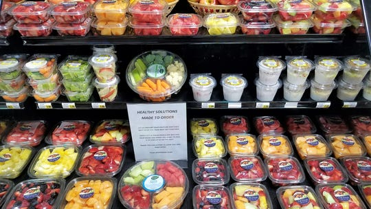 A large variety of freshly-cut fruits and vegetables is available just inside the door at the Crossroads IGA on East Lloyd Expressway.