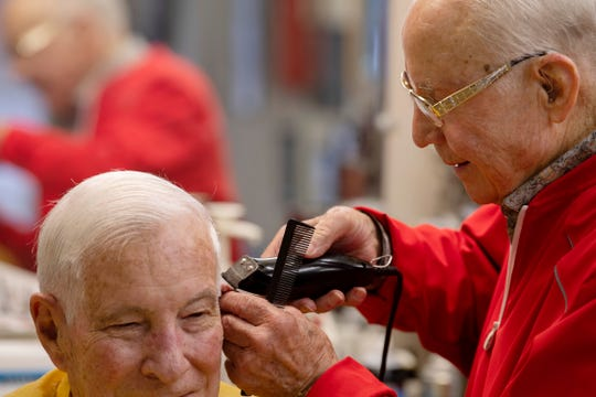 Jay Picking of Evansville gets one of many haircuts by longtime barber George Henson Saturday morning, Jan. 11, 2020. Henson worked his usual half-day cutting hair before celebrating his 90th birthday at two separate parties.