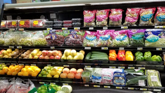 The produce section is small but varied at the Crossroads IGA on East Lloyd Expressway.