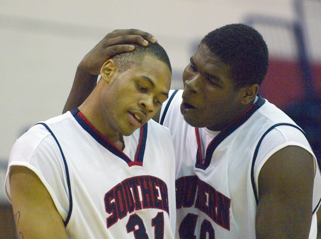 Jeron Lewis, right, is shown in an archive photo comforting teammate Brandon Carr during a USI game.