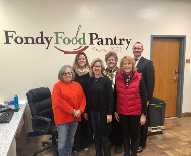 A recent donation by Agnesian HealthCare is helping the Fondy Food Pantry provide eggs and milk to its clients. Jill Wenzel (second from left) and Michael DeGere, MD, (far right) are shown with Fondy Food Pantry representatives, from left: Judy Cusick, Sheri Wagner, Sandy Breth and Sylvia Reed.