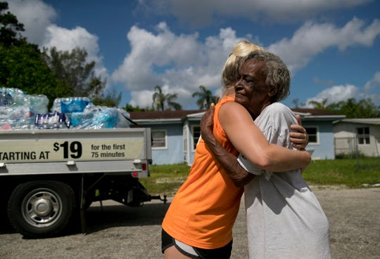 Penny Fletcher thanks Amanda Schoedel of Next Level Church after church volunteers gave her cases of water on Tuesday, September 12, 2017, in the Harlem Lakes community in Fort Myers. The power was out in the neighborhood following Hurricane Irma.
