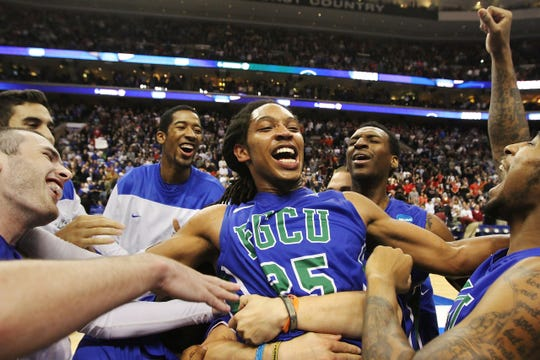 FGCU's Sherwood Brown is lifted during his team's celebration of their victory over San Diego State Sunday at the Wells Fargo Center in Philadelphia. The Eagles won 81-71. Kinfay Moroti / The News-Press