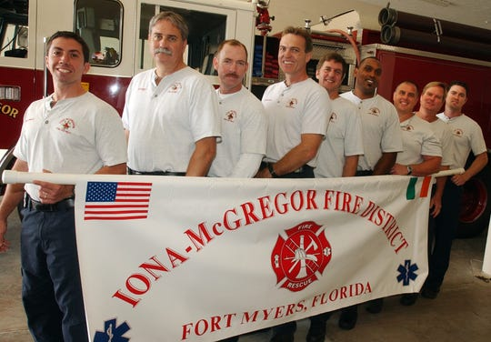 Firefighters with the Iona-McGregor Fire District hold a banner on Tuesday March 14, 2006, that they will be carrying in the St. Patrick's Day Parade in New York City.   (left to right) Antonio Pietripaoli, Tim Kilkelly, Barry Ashman, Chad Jorgensen, Bill Simpson, Tracy McMillion,  Capt. Joe Ursitti, Jim Dougherty, and Marc Mascarelli.