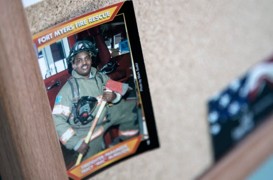 Tracy McMillion's fire trading card from 2002 hangs on the bulletin board in the kitchen of the Fort Myers downtown fire station.