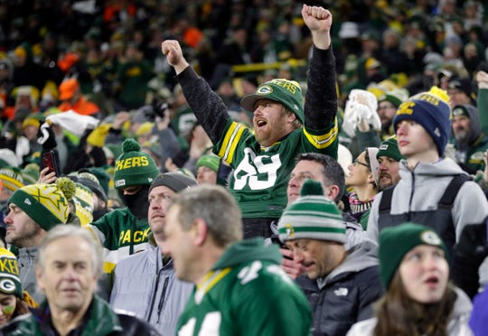 A Green Bay Packers fan cheers during the NFC divisional playoff game against the Seattle Seahawks on Jan. 12, 2020, at Lambeau Field in Green Bay, Wis.