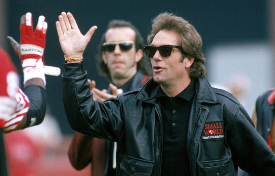 Huey Lewis & The News perform the national anthem before a New York Giants-San Francisco 49ers playoff game in 1991 in San Francisco.