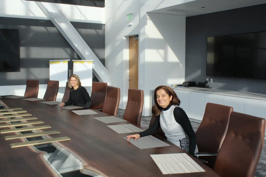 Uzma Samadani, founder of Oculogica, and Jill Enos, managing director of Titletown Tech, in a conference room in Titletown Tech in Green Bay.