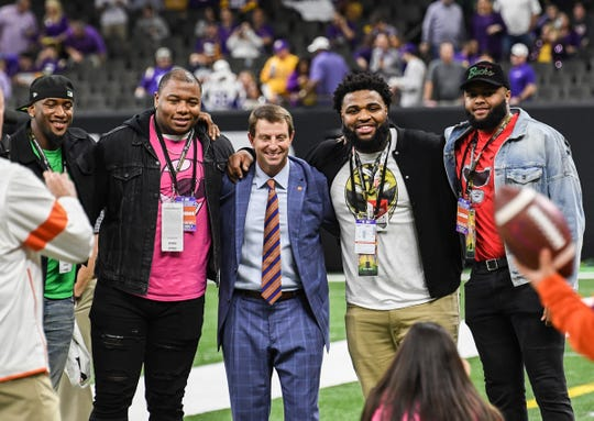 Former Clemson players, from left; Clelin Ferrel, Dexter Lawrence, Christian Wilkins, and Austin Bryant pose with head coach Dabo Swinney before of the College Football Playoff National Championship game in New Orleans Monday, January 13, 2020.