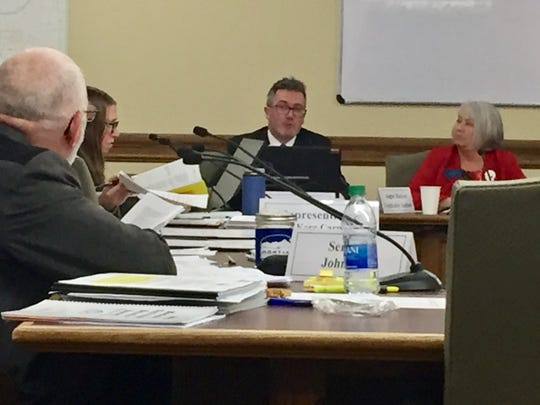 Angus Maciver, legislative auditor, center, fields a question Monday from the Legislative Audit Committee.