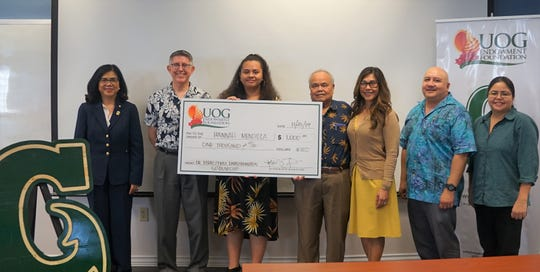 From left, Anita Borja Enriquez, senior vice president of academic and student affairs; Thomas W. Krise, president; Hannah Mendiola; Gerald Perez, husband of Karri Perez and adjunct faculty at UOG; Annette Santos, dean of the School of Business and Public Administration; Lawrence F. Camacho, dean of Enrollment Management and Student Success; and Katrina T. Perez, executive director of the UOG Endowment Foundation.