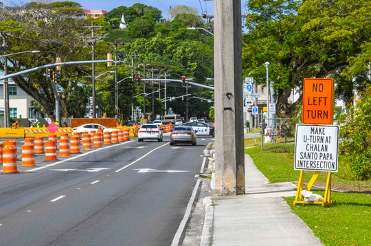 Motorists approach lanes closed off by barriers positioned near a relief sewer line rehabilitation and replacement project, at the intersection of Route 4 and O'Brien Drive in Hagåtña, on Monday