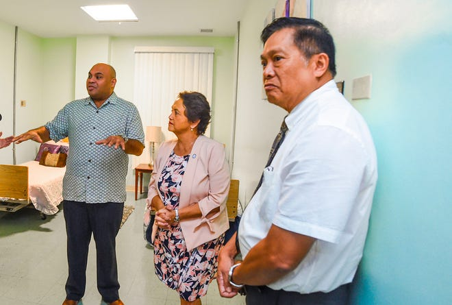 Dr. Abner Pasatiempo, is seen in the foreground, during a visit by Gov. Lou Leon Guerrero and Lt. Gov. Josh Tenorio to the Guam Behavioral Health and Wellness Center in Tamuning in February 2019. Pasatiempo was a staff psychiatrist with agency until he resigned in December 2019.