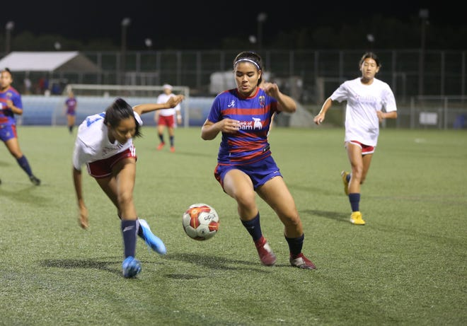 Bank of Guam Lady Strykers' Lauren Phillips controls the ball against Quality Distributors during a Bud Light Women's Soccer League Premier Division match Sunday at the Guam Football Association National Training Center. The Lady Strykers won 3-0.