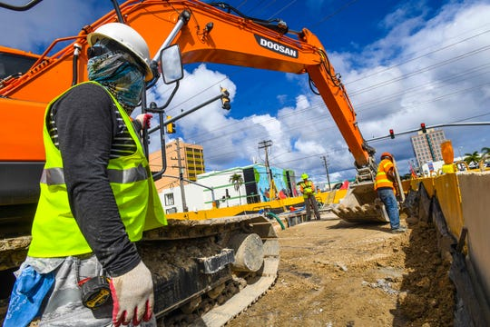 ProPacific Builder Corporation employees continue work on a relief sewer line rehabilitation and replacement project at the intersection of Route 4 and O'Brien Drive in Hagåtña on Monday, Jan. 13, 2020.