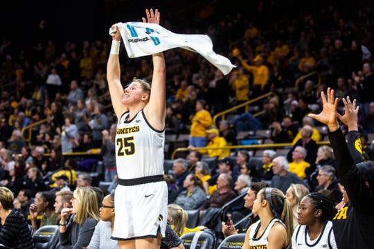 Iowa center Monika Czinano (25) pumps up the crowd during a NCAA Big Ten Conference women's basketball game, Sunday, Jan. 12, 2020, at Carver-Hawkeye Arena in Iowa City, Iowa.