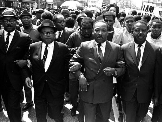 The Rev. Ralph Abernathy, right, and Bishop Julian Smith, left, flank Martin Luther King Jr. during the march in support of the sanitation workers in Memphis on March 28, 1968.