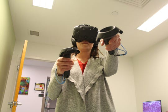 Virtual reality can illustrate abstract concepts and allow people to experience things they otherwise might not be able to. A person experiences a VR scenario on March 21, 2018 in Athens, Georgia.