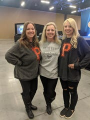 Samantha Vermillion, right, coach of the Powell Middle School cheerleading team, is with her mother, Juanita Young, center, and Powell teacher Jessica Smith.