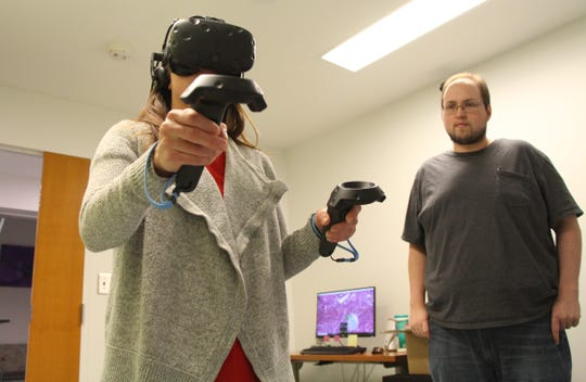 Bryan Trude, a Ph.D. student, helps to oversee research testing the use of virtual reality to educate the public and inspire more flu vaccinations, on March 21, 2018, in Athens, Georgia.