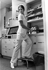 """In a photograph published July 8, 1970, Marion Smith, 21, a registered nurse at Presbyterian Hospital, is the first Knoxville nurse to break the ice and go on duty wearing a pants suit. Smith said the men patients still appear to appreciate her appearance in the new garb. She had permission of her supervisor to change to the pant-uniform """"as long as it is kept professional."""""""