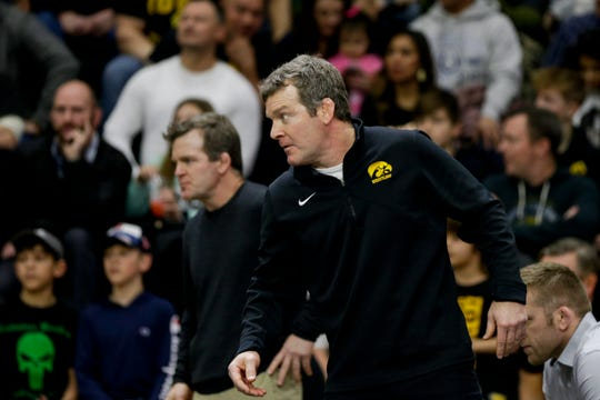 Iowa head coach Tom Brands reacts during a 125 pound bout in a Big Ten dual wrestling match, Sunday, Jan. 12, 2020 at Holloway Gymnasium in West Lafayette.