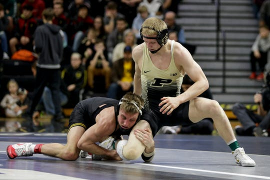 Purdue's Parker Filius wrestles Iowa's Max Murin during a 141 pound bout in a Big Ten dual wrestling match, Sunday, Jan. 12, 2020 at Holloway Gymnasium in West Lafayette.
