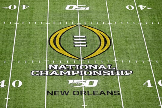 Jan 13, 2020; New Orleans, Louisiana, USA; A view of the CFP National Championship logo on the field before the College Football Playoff national championship game between the Clemson Tigers and the LSU Tigers at Mercedes-Benz Superdome. Mandatory Credit: Stephen Lew-USA TODAY Sports