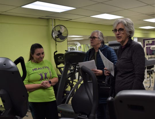Theresa Brunney leads Deb and Rebecca Nixon on a tour of the equipment room in the Olivedale Park Health and Fitness Center Thursday, Jan. 9. The sisters said they were looking to join the center after hearing about it on Facebook.